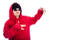 Hip Hop style man. Hip Hop dancer in red hoodie posing, isolated on white background Stock Photos