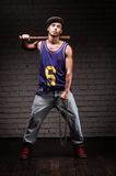 Hip-hop style man holding baseball bat and chain Royalty Free Stock Photos