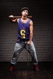 Hip-hop style man holding baseball bat and chain Royalty Free Stock Photos