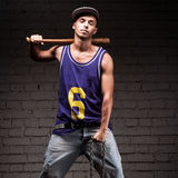 Hip-hop style man holding baseball bat and chain Royalty Free Stock Photography