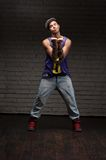 Hip-hop style man holding chain Royalty Free Stock Photography