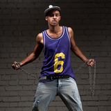 Hip-hop style man holding chain Stock Photo