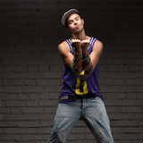 Hip-hop style man holding chain Royalty Free Stock Images
