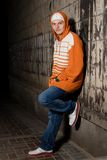 Hip-hop styled boy outdoors. Smiling young rapper guy outdoors at night Stock Photo