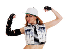 Hip-Hop woman showing muscles. Royalty Free Stock Photo