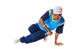 Hip-hop young man making cool move. Isolated on white background royalty free stock photography