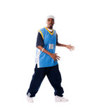 Hip-hop young man making cool move. Isolated on white background royalty free stock photo