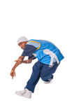 Hip-hop young man making cool move. Isolated on white background stock photography