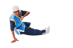Hip-hop young man making cool move. Isolated on white background royalty free stock photos