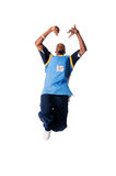 Hip-hop young man making cool move on white backgr Royalty Free Stock Photos