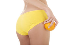 Hip, legs, abdomen and orange in hand. Cellulite, liposuction ,woman weight loss control concept Stock Photos