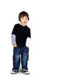 Hip little boy talking. Cute and hip little boy leaning and speaking, hands in the pockets  over white background as copy space ready for text or other Stock Photos