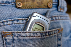 Hip-pocket and phone. In a hip-pocket of jeans the mobile phone lies Royalty Free Stock Images