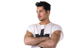 Hip, trendy young man with white t-shirt and necklace. Isolated on white stock photo
