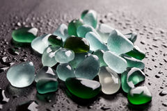 Hip of wet glass pieces polished by the sea Royalty Free Stock Photography