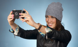 Hip Woman Snaps a Picture of Herself with Vintage Camera Royalty Free Stock Image