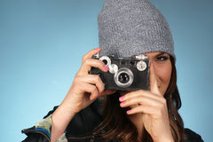 Hip Woman Snaps a Picture of Viewer with Vintage Camera Stock Images