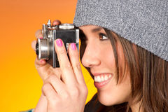Hip Woman Snaps a Picture with Vintage Camera Royalty Free Stock Photo