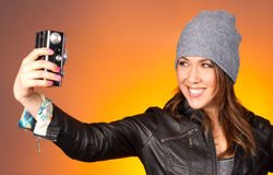 Hip Woman Snaps a Self Portrait with Vintage Camera Stock Photography