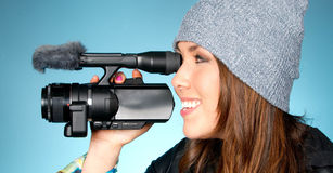 Hip Young Adult Female Points Video Camera Royalty Free Stock Photos