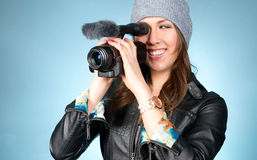 Hip Young Adult Female Points Video Camera Stock Photo