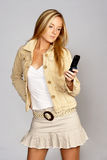 Hip Young Blonde Woman with Mobile Phone Royalty Free Stock Image
