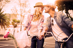 Hip young couple on a bike ride Royalty Free Stock Images