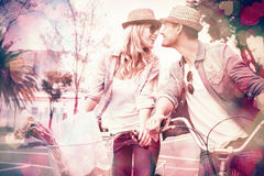 Hip young couple on a bike ride Stock Image