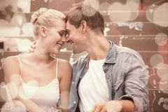 Hip young couple in denim sitting on steps Stock Photos