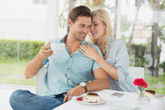 Hip young couple enjoying coffee and desert together Stock Photo