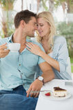 Hip young couple enjoying coffee and desert together Stock Image