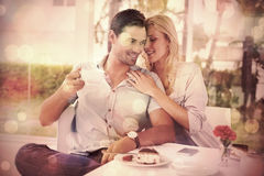 Hip young couple enjoying coffee and desert together Royalty Free Stock Images