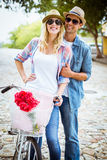 Hip young couple going for a bike ride Royalty Free Stock Photography