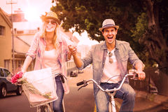 Hip young couple going for a bike ride Royalty Free Stock Image