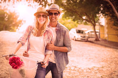 Hip young couple going for a bike ride Stock Photos