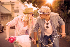 Hip young couple going for a bike ride royalty free illustration