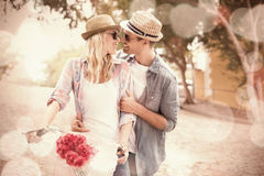 Hip young couple going for a bike ride Royalty Free Stock Photo
