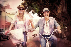 Hip young couple going for a bike ride Stock Images