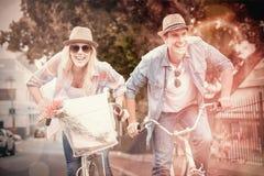 Hip young couple going for a bike ride Stock Photos