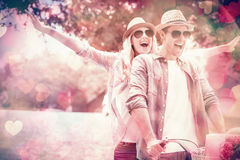Hip young couple going for a bike ride Royalty Free Stock Images