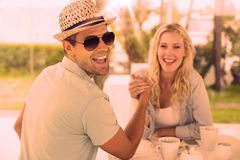Hip young couple having coffee together royalty free illustration