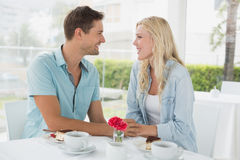Hip young couple having desert and coffee together Stock Images
