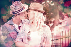 Hip young couple kissing by railings Royalty Free Stock Photo