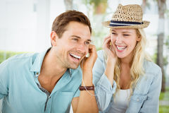 Hip young couple listening to music together Stock Photography