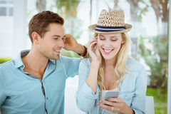 Hip young couple listening to music together Stock Images