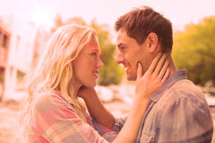 Hip young couple smiling at each other Royalty Free Stock Photo