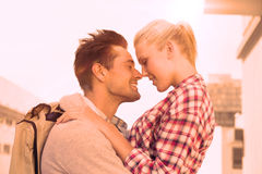 Hip young couple smiling at each other Stock Images