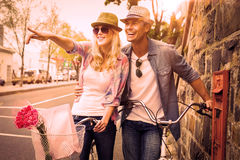 Free Hip Young Couple Standing By Brick Wall With Their Bikes Stock Photos - 49568333
