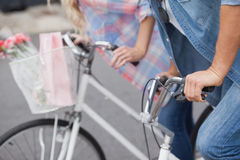 Hip young couple on their bikes Royalty Free Stock Photo