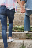 Hip young couple walking up steps Royalty Free Stock Images